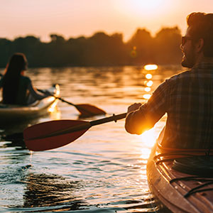 Couple canoeing on river